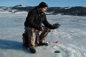 Ice fishing near Lyngstrand Camping
